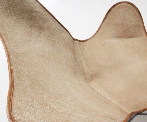 Fauteuil butterfly toile bordé cuir BAIGE